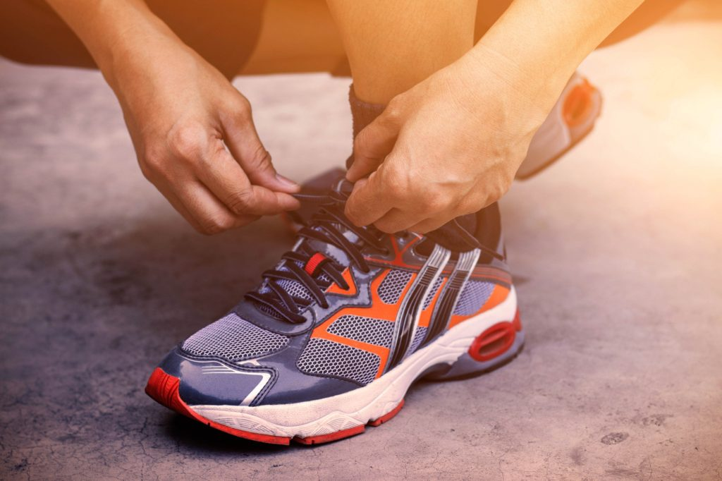 Hands tying shoes for jogging